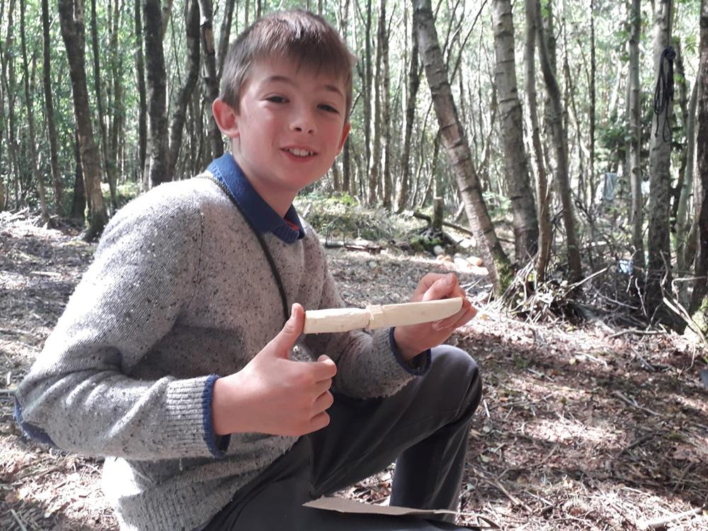 Oliver whittling a knife